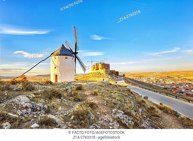 Windmill and castle at the background. Consuegra. Don Quixote route. Toledo. Castile-La Mancha. Spain