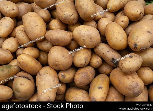 Singapore, Republic of Singapore, Asia - Fresh potatoes are sold at a street market in Little India