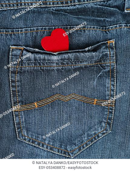 small red heart in the back pocket of blue jeans, full frame