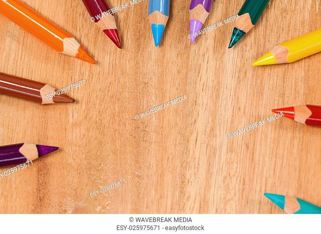 Colored pencils arranged in a semi-circle