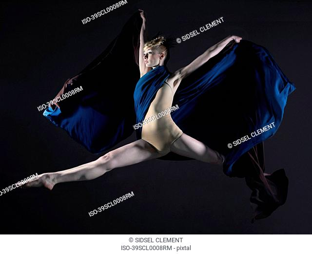 Dancer leaping with sheer scarf