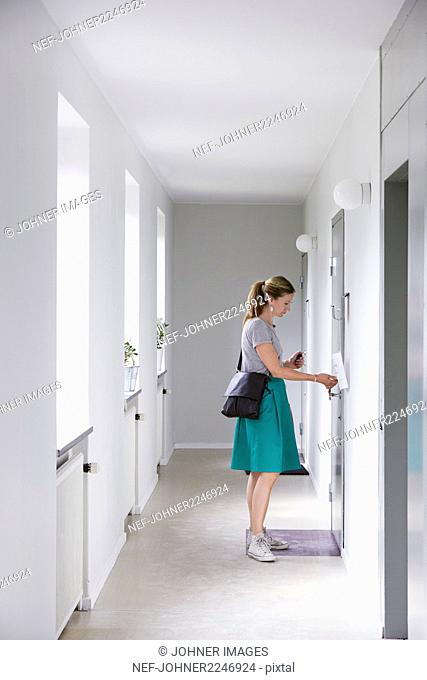 Young woman opening doors