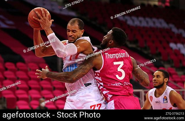 Bonn, Germany, 09. 01. 2021, Telekom Dome, Basketball Bundesliga, Telekom Baskets Bonn vs s. Oliver Wuerzburg: Alex Kink (Wuerzburg) und James Thompson IV...