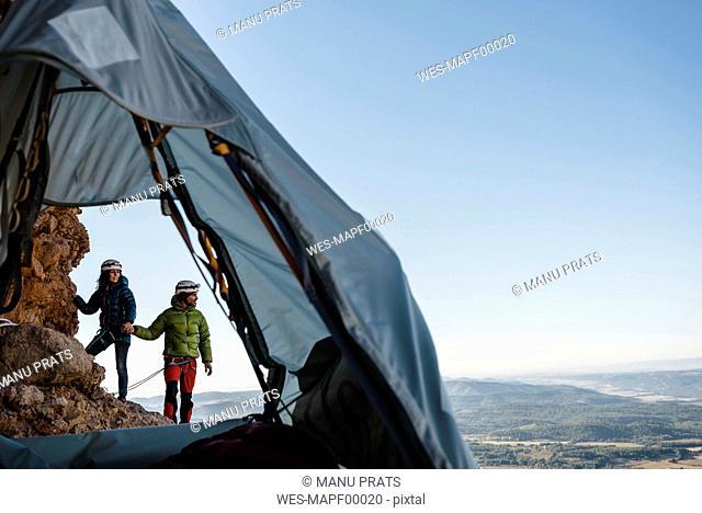 Spain, Huesca, Mallos de Riglos, climber couple with tent at rock wall