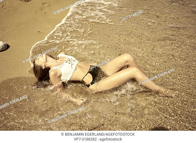 young sensual woman on beach