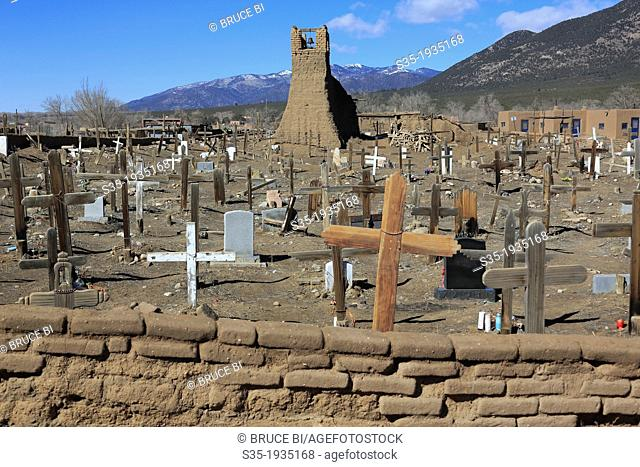 The Taos Pueblo Cemetery with original San Geronimo Church in the background. Taos. New Mexico. USA
