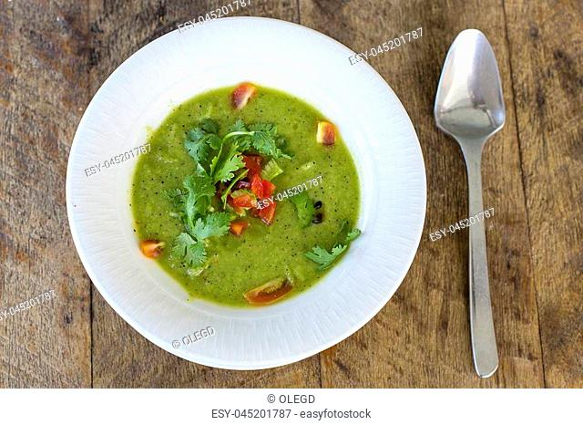 Traditional Spanish cold soup gazpacho on wooden table, close up
