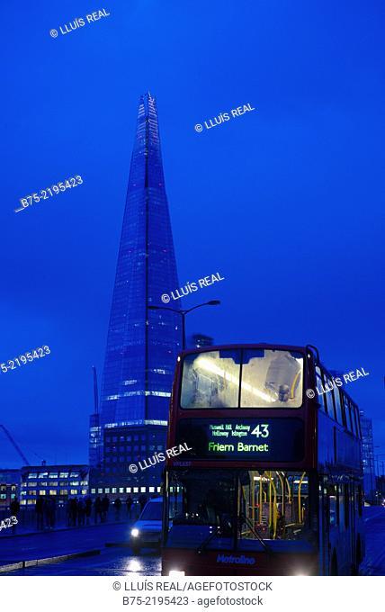 Bus 43 'Frien Barnet' goin through London Bridge and The Shard building on the background, London, England, UK