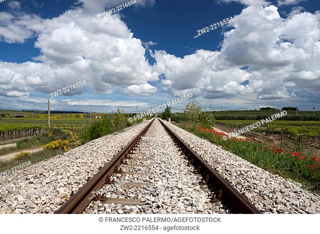 Railway tracks and white clouds in springtime. Canosa DP, Puglia. Italy