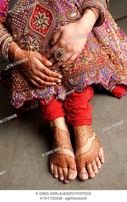 Close up of hand and foot mehndi