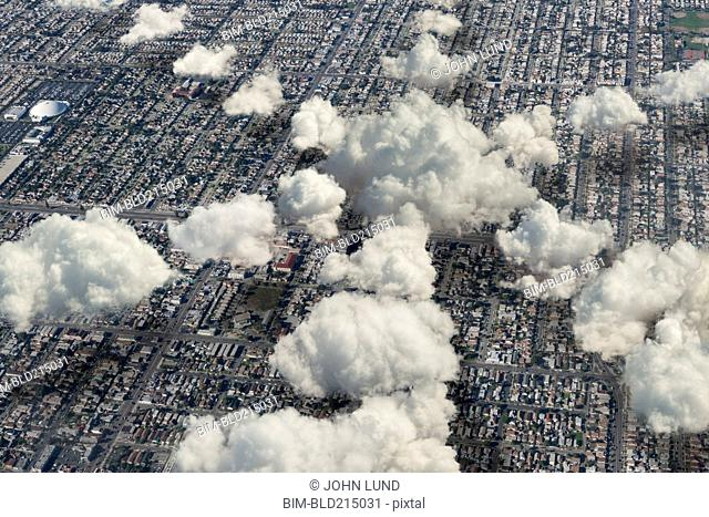 Aerial view of clouds in shape of star over cityscape