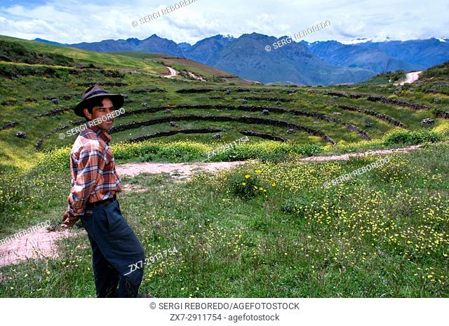 A pastor in the archaeological site of Moray in the Sacred Valley near Cuzco. Moray - is the name of the Incan ruins near the town of Maras