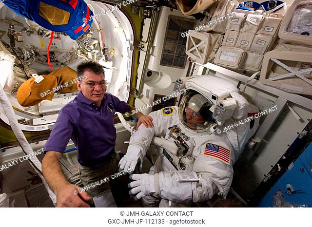 European Space Agency astronaut Paolo Nespoli (left), Expedition 26 flight engineer; and NASA astronaut Steve Bowen, STS-133 mission specialist