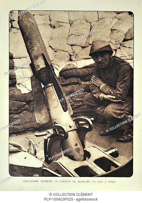 Soldier and trench mortar loaded with bomb in Flanders during the First World War, Belgium