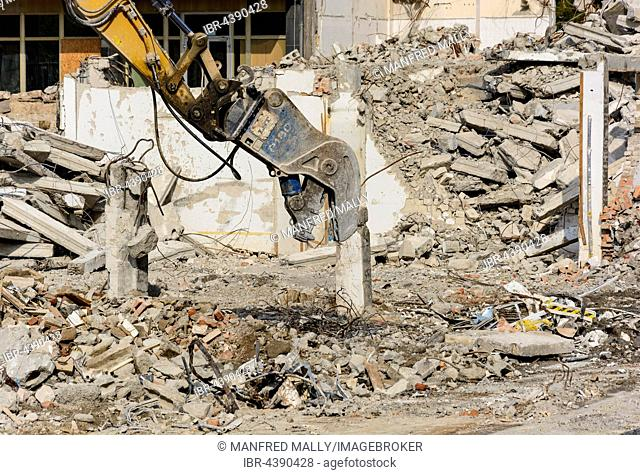 Demolition work, excavator with rubble, Dresden, Germany