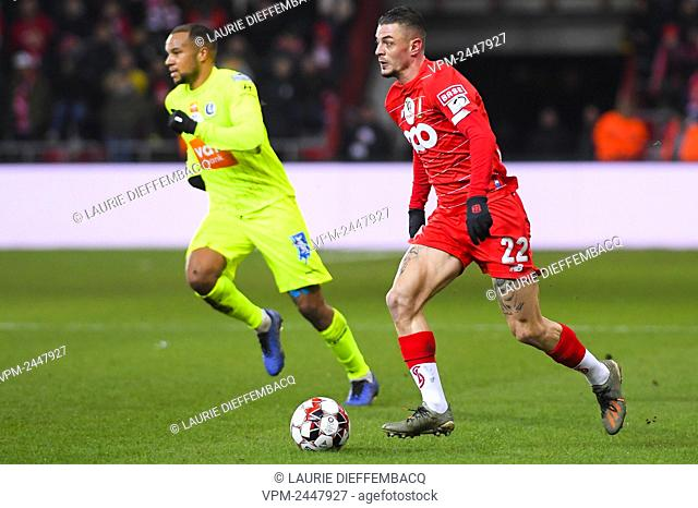 Standard's Maxime Lestienne and Gent's Vadis Odjidja-Ofoe fight for the ball during a soccer match between Standard de Liege and KAA Gent