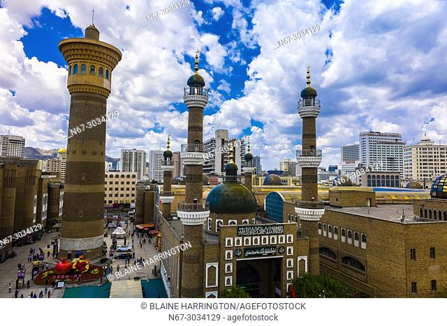 Tower, International Grand Bazaar and Mosque, Urumqi, Xinjiang Province, China. Urumqi is the capital of the Xinjiang Uyghur Autonomous Region of the People's...