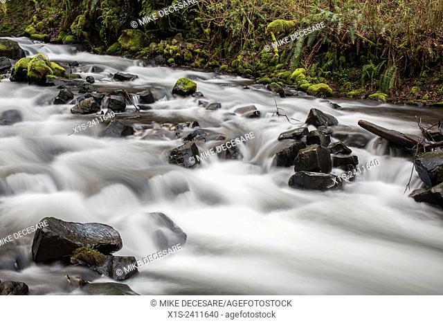 River runs fast below Bridal Veil Falls in the Pacific Northwest, in Oregon