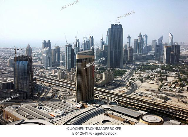 View of the Dubai Mall in front of the skyline of the buildings on Sheikh Zayed Road, Downtown Dubai, United Arab Emirates, Middle East