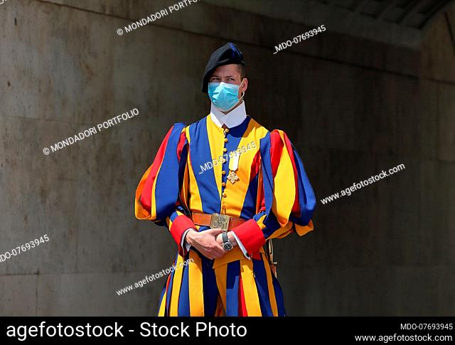 Angelus. The Pontifical Swiss Guards on duty at the Arco delle Campane wear masks to protect themselves from the coronavirus