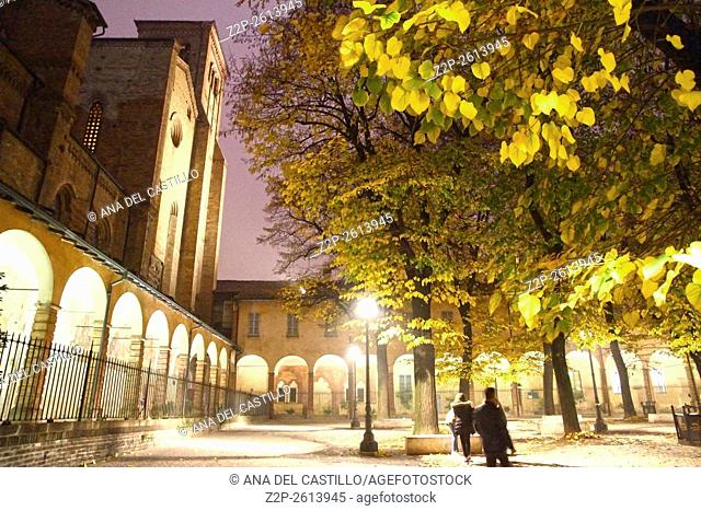 Autumn park by night Piacenza Italy San Francesco church