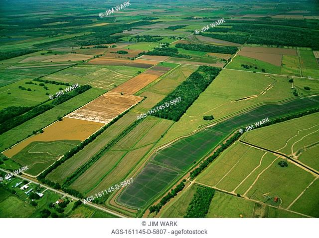 Agriculture - Aerial view of various agricultural fields in Spring, including rice fields in stages of flooding and early growth / LA - Vermilion Parish