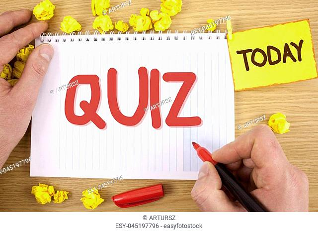 Text sign showing Quiz. Conceptual photo Short Tests Evaluation Examination to quantify your knowledge written by Man Notepad holding Marker wooden background...