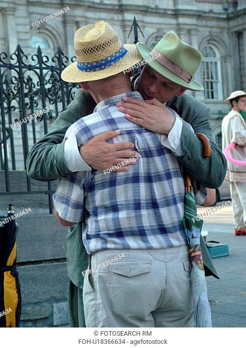 Montreal, Canada, QC, Quebec, Old Port, Old Montreal, Place Jacques Cartier, street artist, mime hugging man