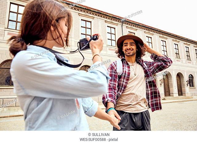 Young tourist couple walking in courtyard of Munich Residenz, Munich, Germany