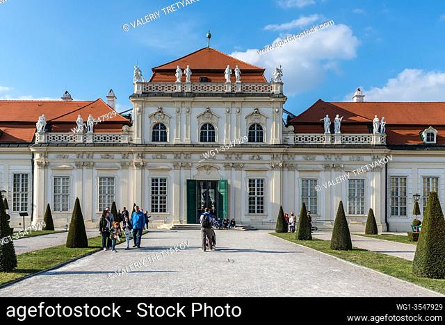 Vienna, Austria - April 17, 2019: The Lower Belvedere Palace and garden in the Belvedere complex in Vienna, Austria. People walk in front of the palace