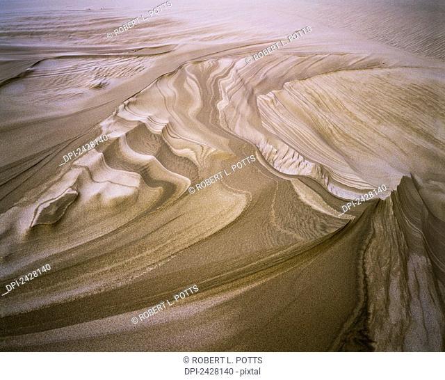 Erosion reveals layers of sand; Lakeside, Oregon, United States of America