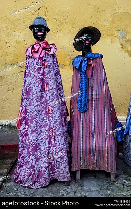 Traditionally dressed mannequins outside of the La Merced Convent, Antigua, Guatemala,