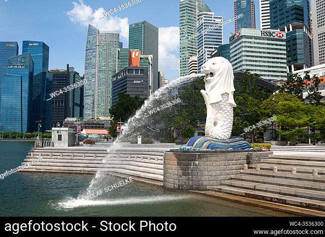 Singapore, Republic of Singapore, Asia - Abandoned Merlion Park with fountain along the banks of the Singapore River and skyscrapers of the central business...
