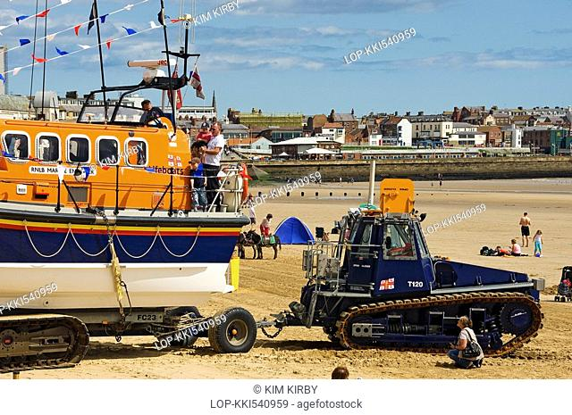 England, East Riding of Yorkshire, Bridlington, RNLI lifeboat 'Marine Engineer' being transported on the beach