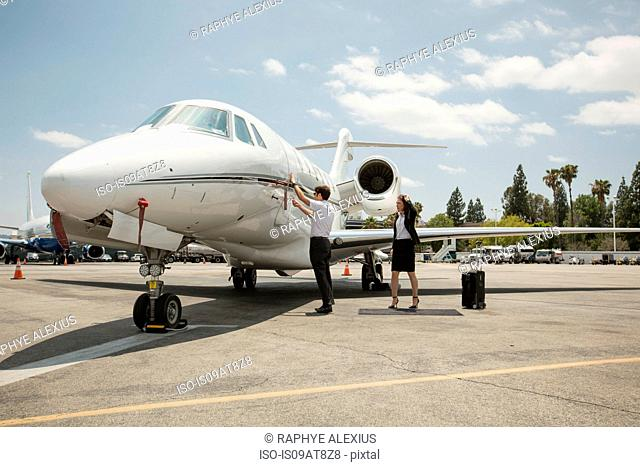 Female businesswoman preparing to travel in private jet at airport