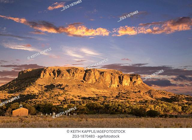 Black Mesa and Adobe church during sunset, Pajartio, New Mexico, USA