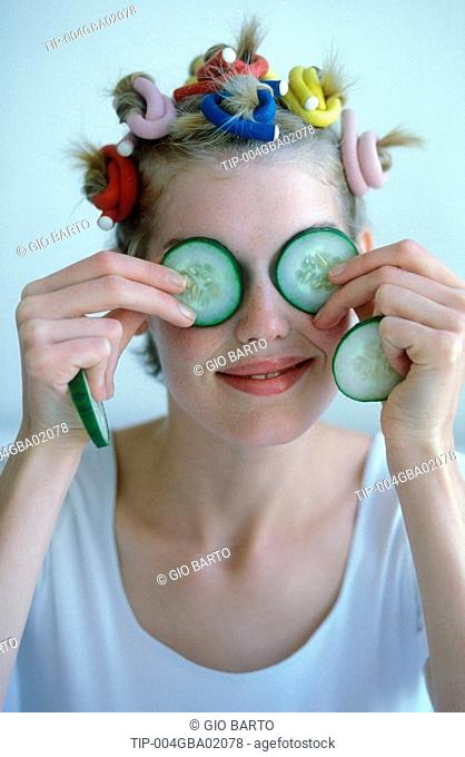 Woman with cucumber on her eyes
