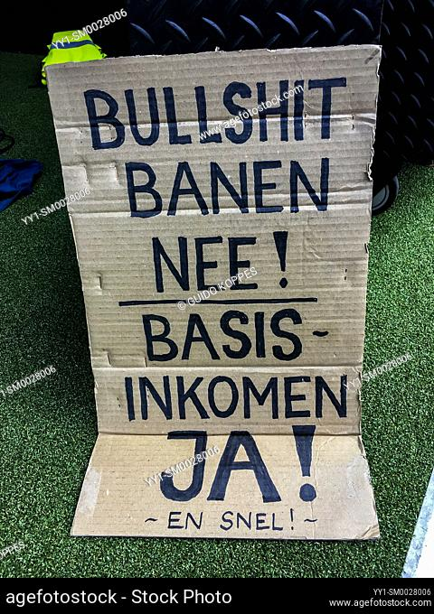 Amsterdam, Netherlands. Basic Income Demonstration Sign against dead end jobs and in favour of Basic Income for all