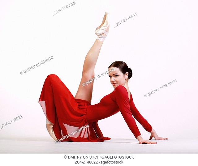 Ballerina posing in red dress