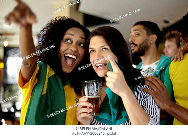 Brazilian football supporters watching match in bar