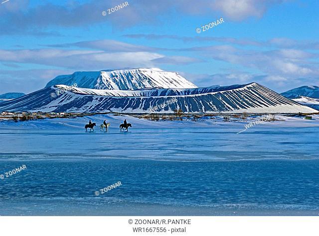 Horse riders on lake myvatn