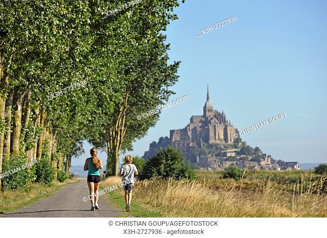 joggers on a path in polders of the Mont-Saint-Michel bay, Manche department, Normandy region, France, Europe