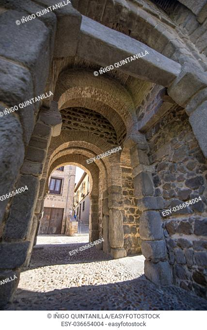 inside ancient building Alfonso VI Gate, landmark and ancient age monument from tenth century, one of the pedestrian public access to Toledo city, Spain, Europe