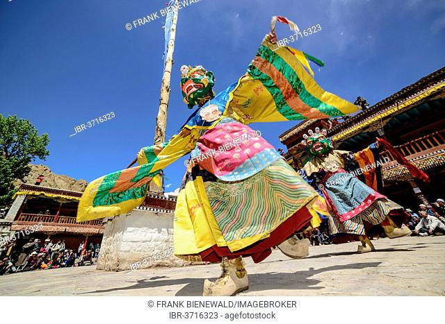 Monks performing ritual mask dance, describing stories from the early days of Buddhism, during Hemis Festival, Hemis, Ladakh, Jammu and Kashmir, India
