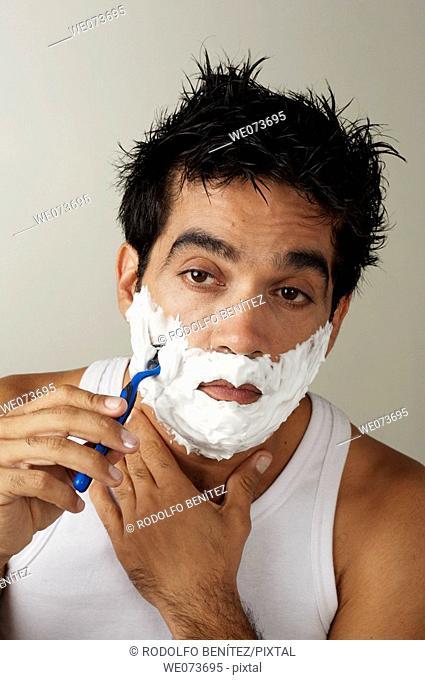 Latin man shaving