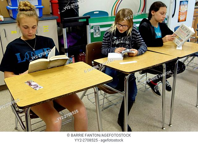6th Grade Girls Reading Books, Wellsville, New York, USA