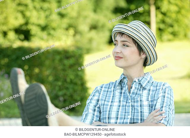 Woman takes it easy in the garden, portrait