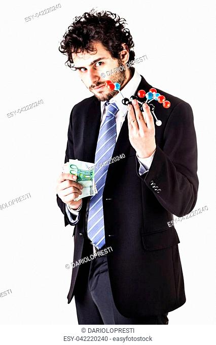 a businessman wearing a suit and a tie holding a trinitrotoluene tnt molecular model and money bills isolated over white