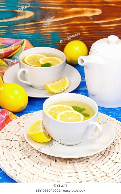 Green tea with mint and a lemon. Macro, selective focus