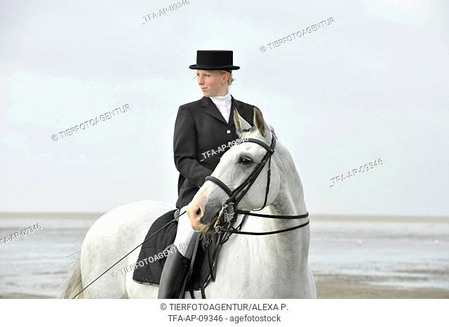 woman rides Andalusian horse